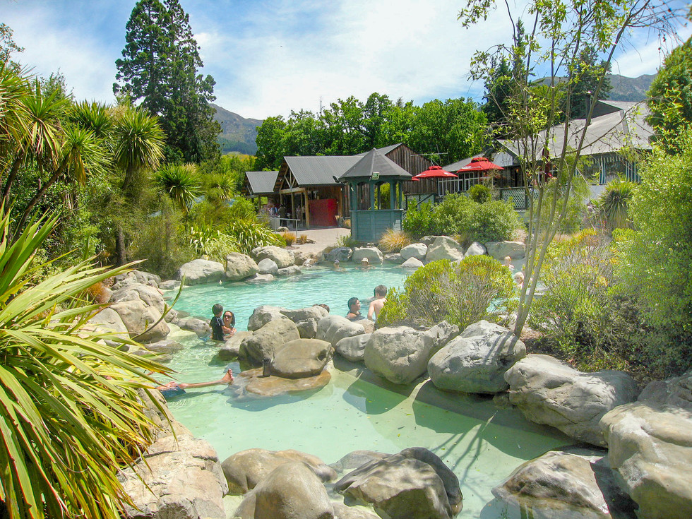 Natural thermal pools design with boulders and landscape planting at Hanmer Springs