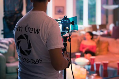 Reyfilm setting up film lighting.