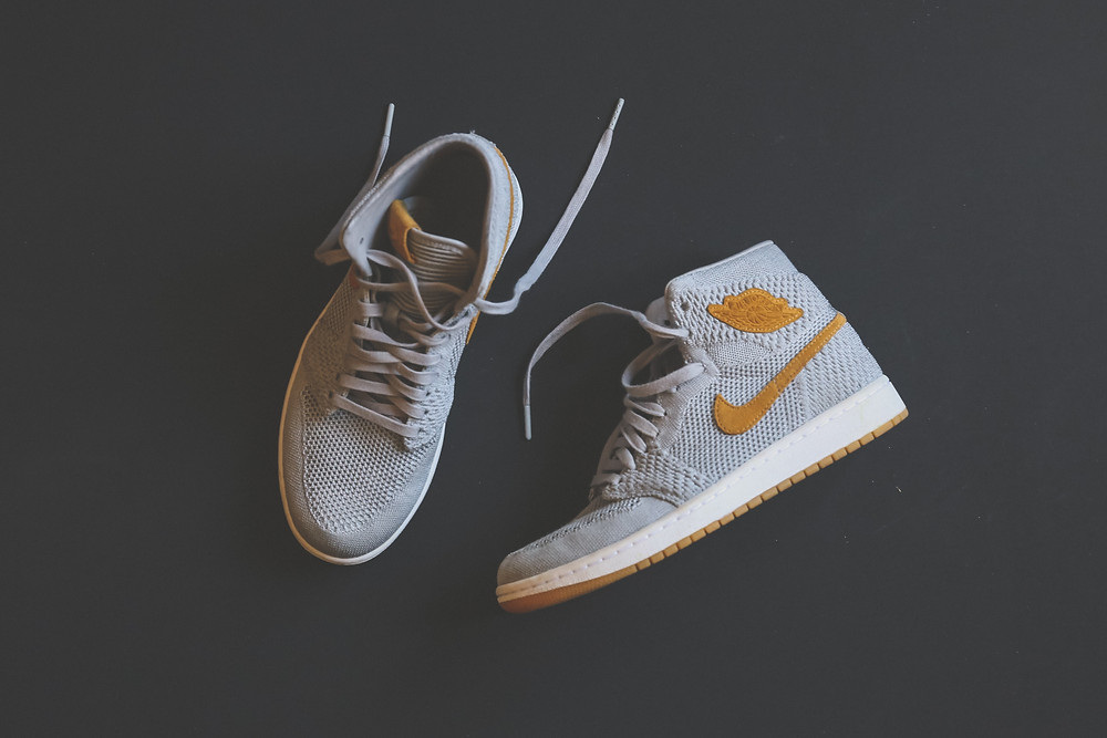 A pair of high-top Nike shoes are a great example of company branding.