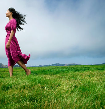Woman on grassy mountaintop