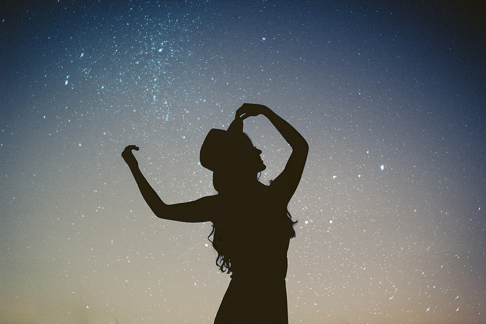 Women with a starry star as a background