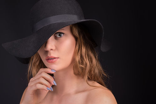 Beauty in a floppy hat