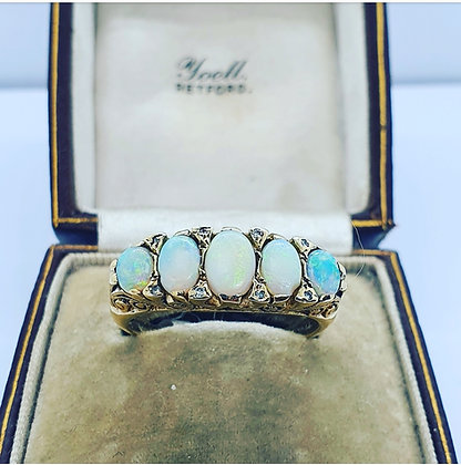 Opal five stone ring