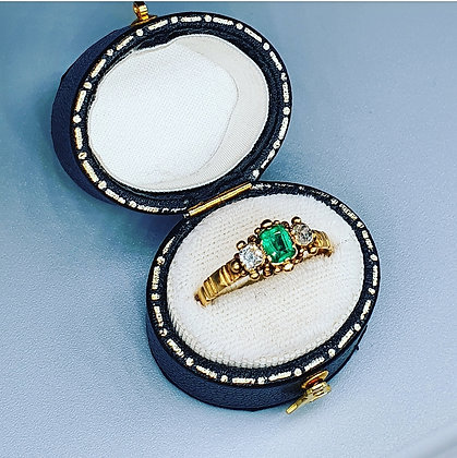 Antique emerald and diamond trilogy ring