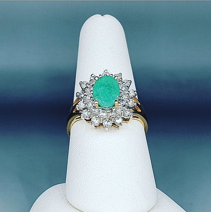 Emerald and diamond halo cluster ring