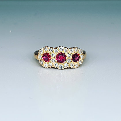 Ruby and diamond cluster trilogy ring