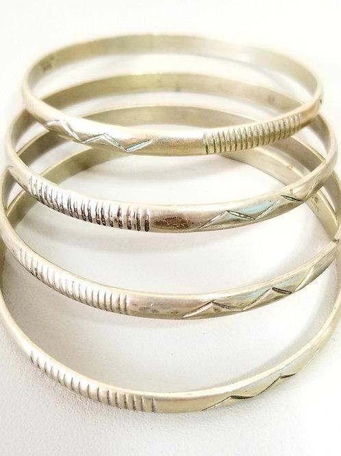 Set of 4 beautiful handcrafted Vintage 925 Sterling silver bracelets.
