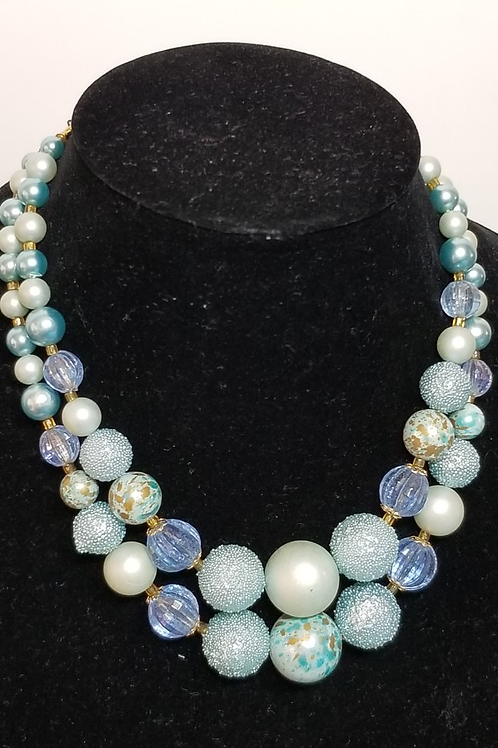 Vintage double strand pearl like and crystal necklace.