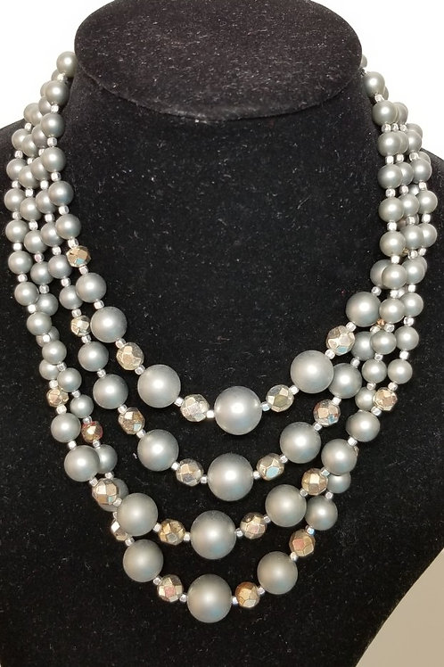 Pearl like stone necklace. 4 strands.
