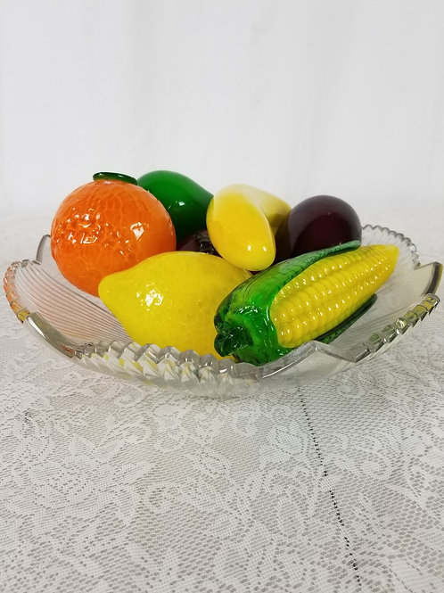 Glass bowl with assorted glass fruits.