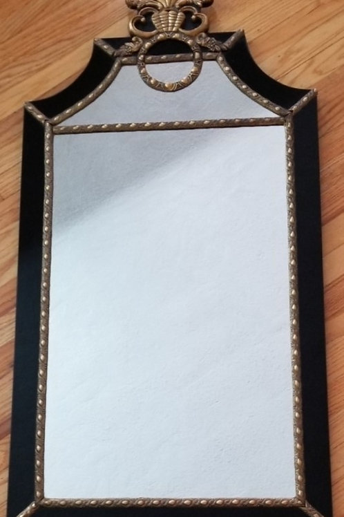 Mirror with black frame and gold trim
