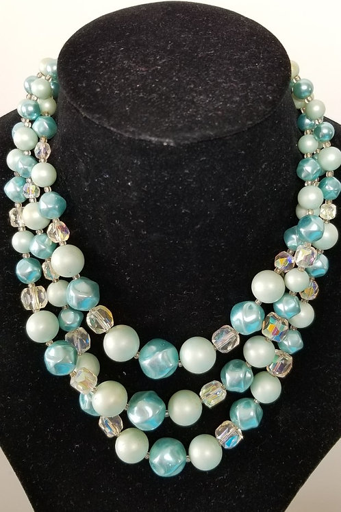 Beautiful combination of pearls like and glass vintage art necklace.