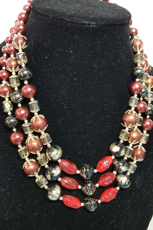 Vintage triple strand costume necklace.