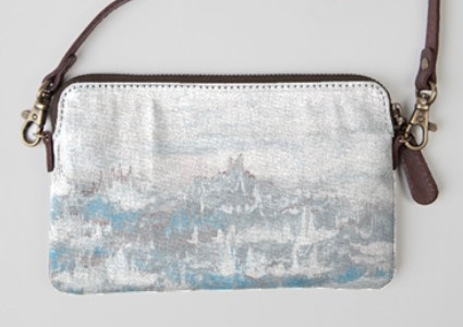 Statement clutches made of leather and canvas featuring one of Elizabeth's paintings.