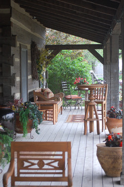 Front porch of the log home.