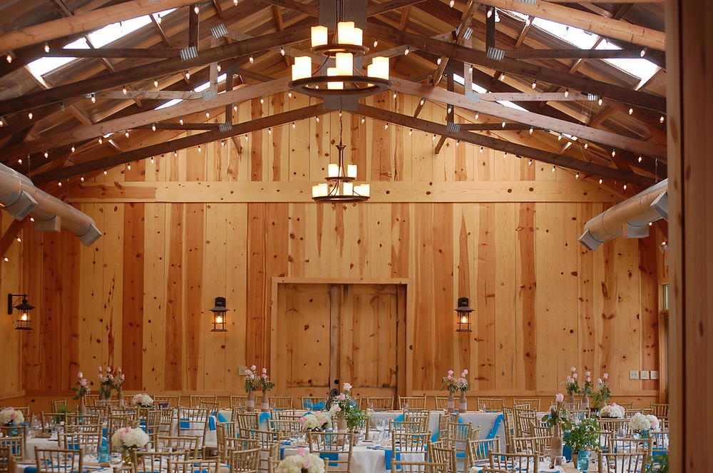 Pine walls and twinkling lights accent the barn beautifully.