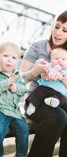 A mum is using sign language with her young son