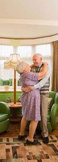 An older couple is dancing