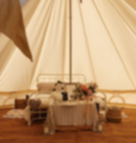 Bridal Suite in an outdoors tent decorated wit flowers and textile
