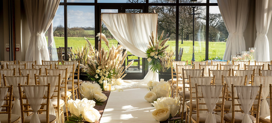 ceremony with backdrop and giant flowers