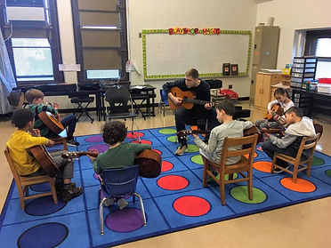 Kris Monson teaching music