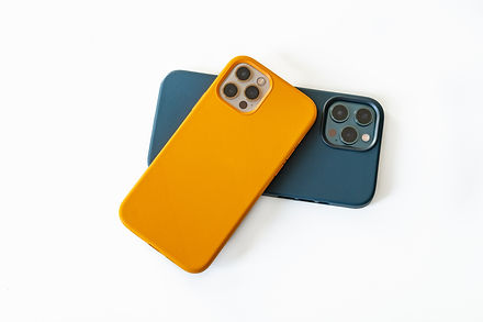 Modern mobile phones in blue and yellow
