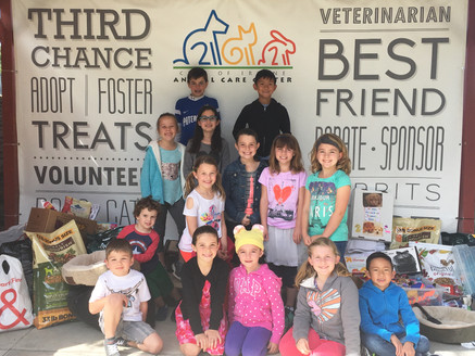 OC Kids Giving Back donated stuff to dogs!