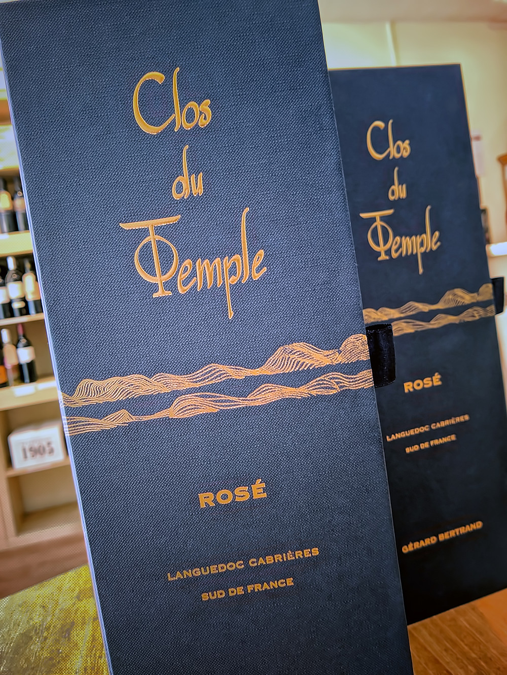 Blue gift box for Clos du Temple by Gérard Bertrand with gold coloured lettering and graphics.