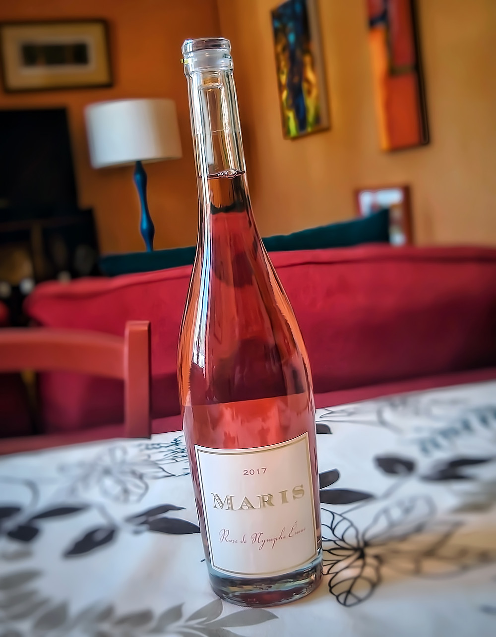 Château Maris, Rose de Nymphe Emue, Rose Wine on a dining table.