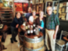 Happy people at a wine shop enjoying a Cocoa & Grapes Chocolate and Wine Private Tasting Experience Carcassonne France.