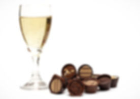 A glass of Champagne with a selection of handmade chocolates for tasting together