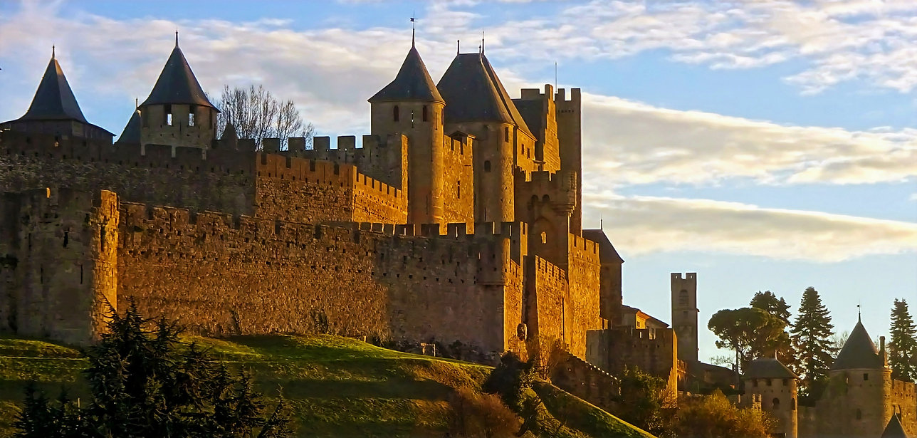 the walls and towers of the medieval city of Carcassonne at sunset