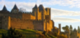Medieval city of Carcassonne at Sunset. Chocolate and Wine Tasting Walking Tours Carcassonne France.