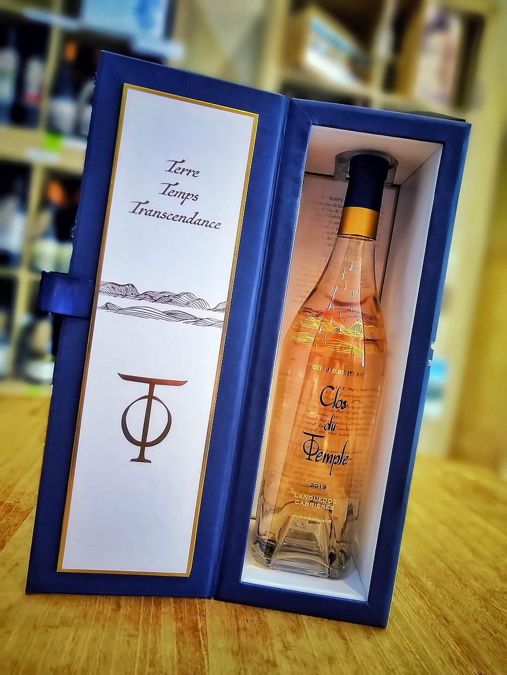 An elegant bottle of Clos du Temple Rose Wine by Gérard Bertrand inside a very special gift box.