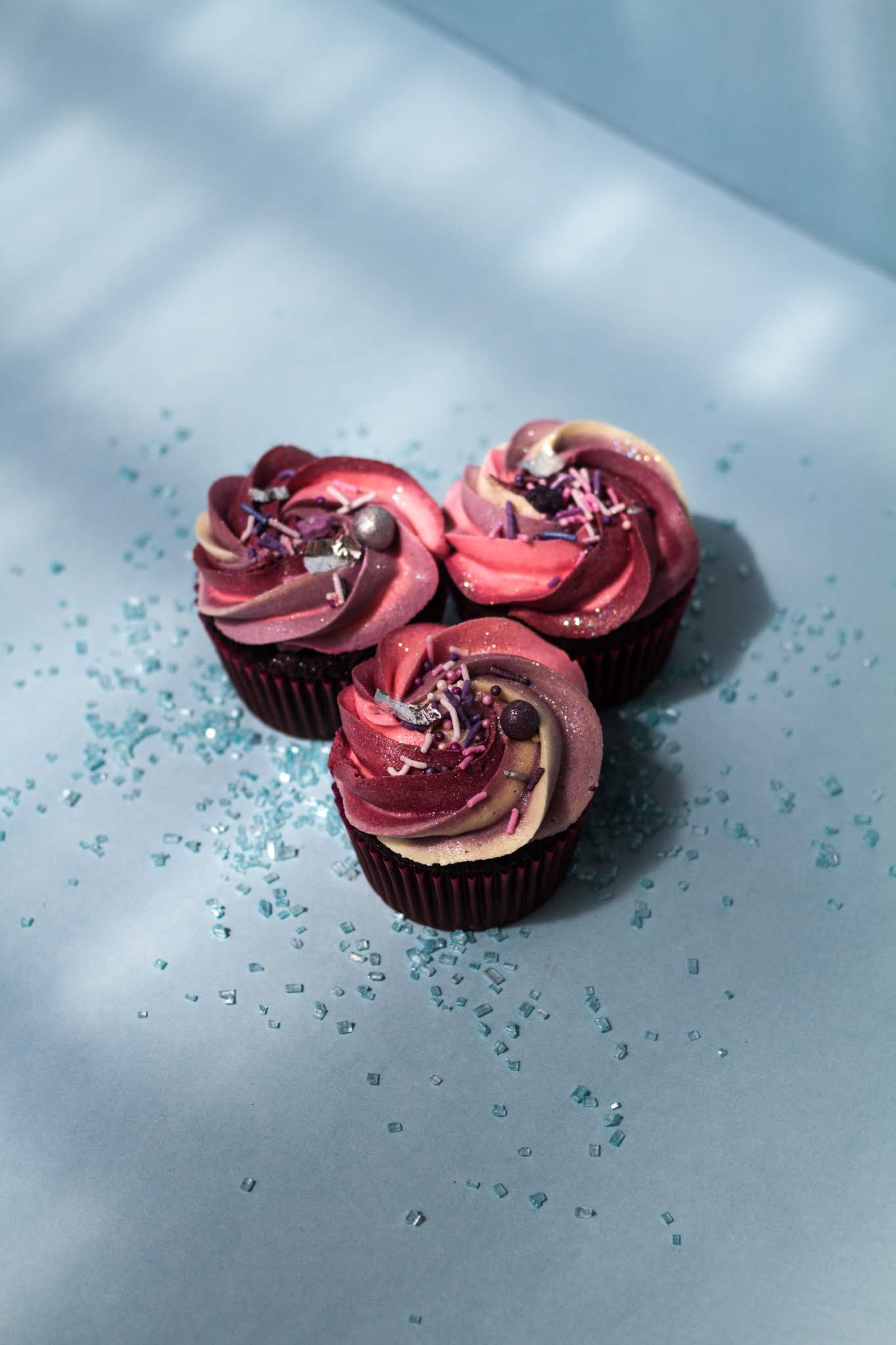 Red and purple icing on cupcake