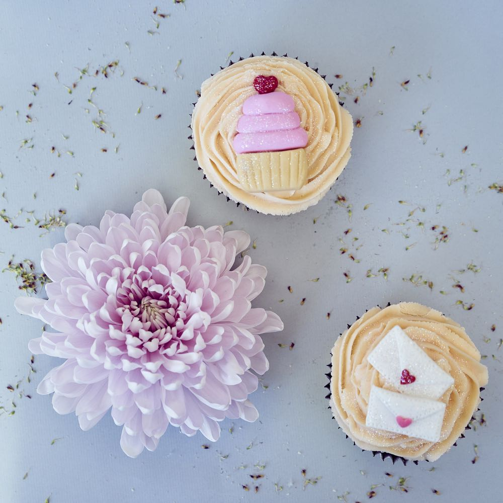 Two custom cupcakes and a flower