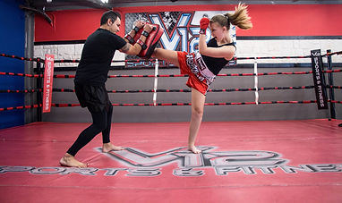 Fight with top trainers at V12 Sports and Fitness in League City TX