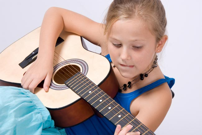 Girl learning to play guitar.jpg