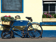 Bicycle with flower basket outside pub, Wicklow