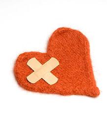 Red felt heart with plaster cross