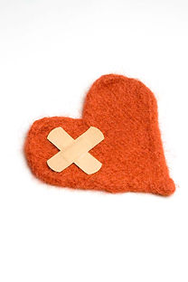fabric heart with bandaids on it representing healing your relationships though online counseling at mckenziecounseling.org