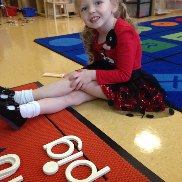 ECLA students learn early literacy skills through the Souns curriculum.