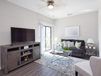 The living area of a furnished model apartment