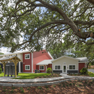 The clubhouse under beautiful oak trees
