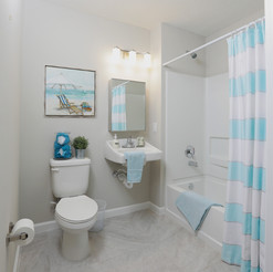A bathroom in the furnished model