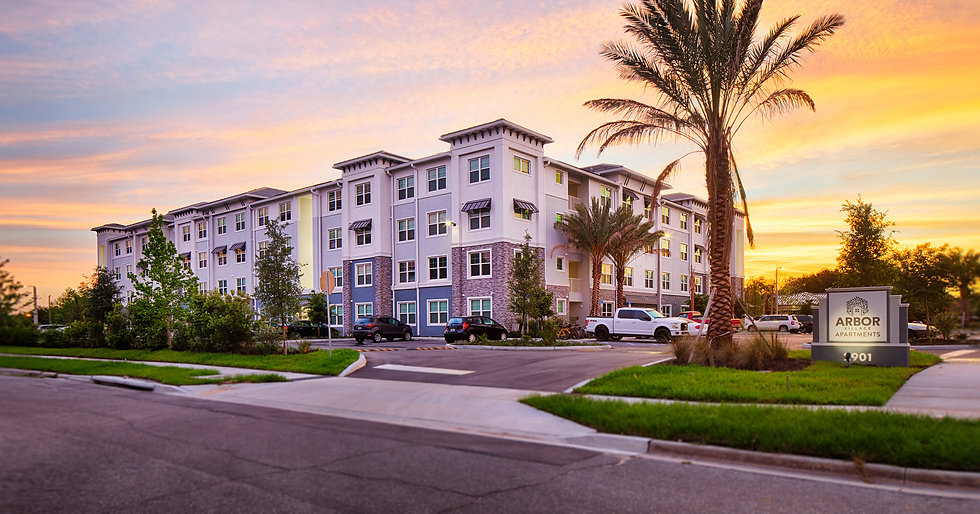 A beautiful sunset image of the exterior of  Arbor Village