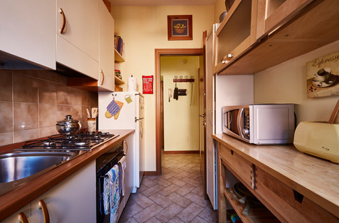 Galley style kitchen is very well-equipped.