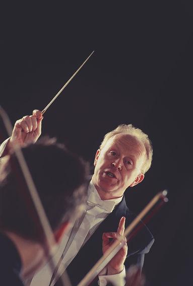 man conducting his orchestra