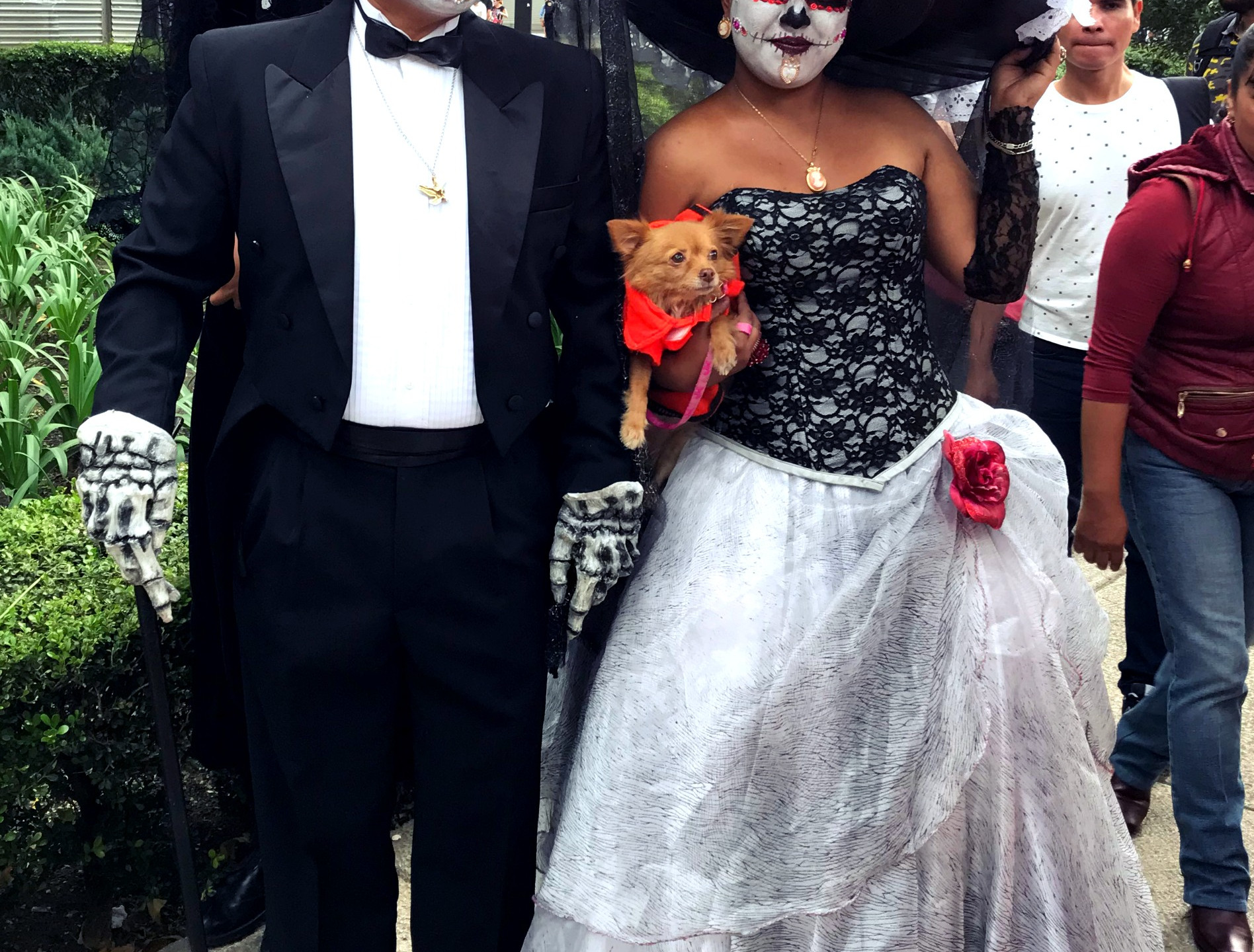 A couple in Catrina face paint and cosumes.