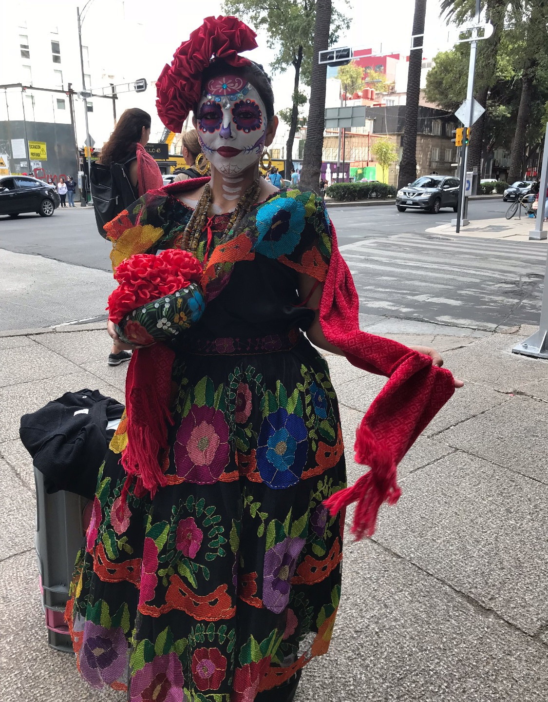 Woman dressed in a Catrina cosume in honor of el dia de los muertos.